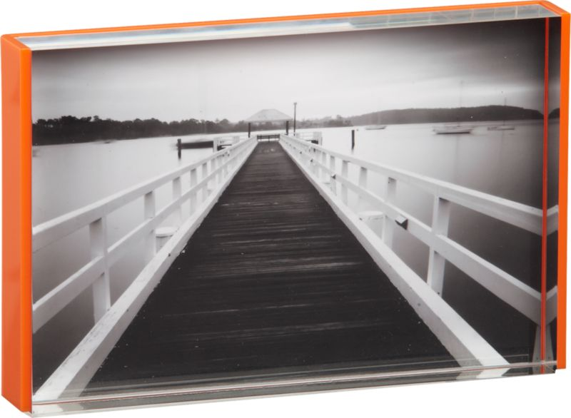 "<span class=""copyHeader"">flash frame.</span> Clear acrylic frame edges a single 4x6 in bright matte orange. Freestands horizontal/vertical on shelf, console or coffee table.<br /><br /><NEWTAG/><ul><li>Acrylic</li><li>Dust with soft cloth</li></ul><br />"