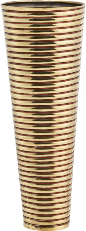 "<span class=""copyHeader"">brass rings.</span> Inspired by the coiled metal arm bands worn by the women of Rajasthan, India, this gleaming brass and copper wire vase reflects a cultural tradition. In this region, the quality and abundance of jewelry adorning the women from head to toe is indicative of a family's social status. Heated and hammered to form concentric rings, this vessel was handcrafted by traditional sheet metal artisans, known as thateras, in the small town of Rewari. Here on the outskirts of New Delhi, families have created decorative metalwork for centuries. Designer Neelima Rao observes: ""This piece keeps alive a visual vocabulary of craft.""<br /><br /><span class=""copyHeader"">neelima rao.</span> Working primarily in metal and semi-precious stones, designer Neelima Rao creates objects that are a modern reflection of India's rich tradition of art and craft. ""The combination of the decorative Indian crafts when juxtaposed with the demands of modernity and simplicity often gives rise to unexpected and unique fusion pieces,"" Rao says. Based in Faridabad, New Delhi, Rao finds inspiration in every village, town and city she travels to throughout India, each of which has its own craft or tradition of personal adornment or objects.<br /><br /><span class=""copyHeader"">CB2 Edition LMTD:</span> CB2 Edition LMTD original works are offered one time only in a small reserve. This special CB2 Edition LMTD design has a limited-edition release of 75.<br /><br /><NEWTAG/><ul><li>CB2 Edition LMTD design by Neelima Rao</li><li>Handcrafted of brass sheet metal with polished copper wire</li><li>Wipe with clean dry cloth</li></ul>"