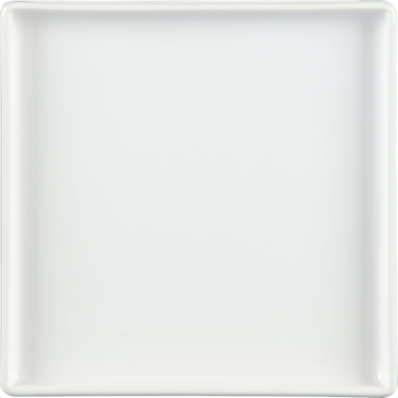 "<span class=""copyHeader"">square meal.</span> Go-to, go with everything dinnerware turns a corner in smart white stoneware. Raised rims square off interactive plates.<br /><br /><NEWTAG/><ul><li>Durable glazed stoneware</li><li>Dishwasher- and microwave-safe</li></ul>"