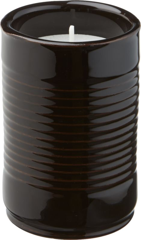 """<span class=""""copyHeader"""">ripple effect.</span> Set the patio aglow with a wink to a familiar pantry form. Handmade of terracotta, ridged cylinder is dip-glazed hi-gloss black, revealing hints of clay beneath. Poured wax candle is infused with citronella to ward off unwelcome guests at your al fresco get-togethers.<br /><br /><NEWTAG/><ul><li>Handmade</li><li>Terracotta</li><li>Hi-gloss black dip-glaze</li><li>Poured wax candle with citronella</li><li>Outdoor use only</li><li>Wipe clean with soft, damp cloth</li></ul>"""