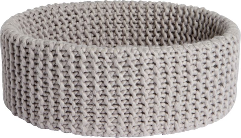 """<span class=""""copyHeader"""">knitting circle.</span> Chunky handwoven crochet round nests clothes, towels, blankets, toys. Light grey basket cozies up with enough depth to conceal clutter.<br /><br /><NEWTAG/><ul><li>Handwoven crochet</li><li>100% acrylic</li><li>Hand wash in cold water, air dry</li></ul><br />"""