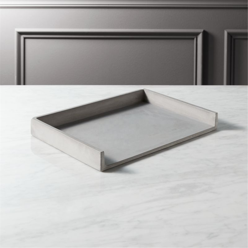 """<span class=""""copyHeader"""">concrete idea.</span> Stackable office staple cements an industrial spot for bills, notes and to-do's. Honed smooth in matte grey with natural intonations, concrete works a minimalist architectural touch in the office. Perfect office mates with cement pencil cup and catchall.<br /><br /><NEWTAG/><ul><li>100% concrete</li><li>Each will be unique</li><li>Stackable</li><li>Wipe with clean cloth</li></ul>"""