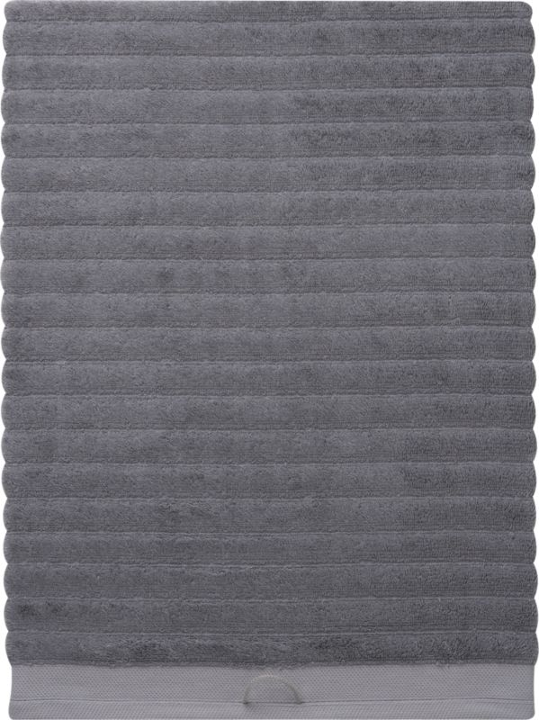 """<span class=""""copyHeader"""">get in line.</span> Raised fluffy grey ribs channel a silky blend of 65% rayon made from bamboo and 35% Egyptian cotton. Bordered in jacquard woven 100% cotton. Eco-friendly SKAL-certified dyes. Super soft, super absorbent, super spa.<br /><br /><NEWTAG/><ul><li>Ribbed channel design</li><li>Made with soft, highly absorbent (600 grams), pre-shrunk yarns</li><li>65% bamboo rayon, 35% Egyptian cotton</li><li>Machine wash warm, tumble-dry low</li></ul>"""