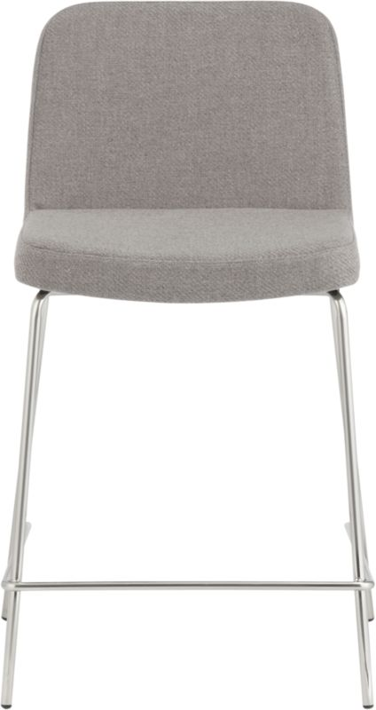 "<span class=""copyHeader"">high dining.</span> Pull up a seat and stay awhile. Dapper stool dines comfy at counter height, upholstered in warm grey herringbone menswear. Tailored trim in carefree acrylic with welt detail that traces rounded corners from curved shoulders to edge of seat. Tubular metal legs stand spare and sleek in polished nickel finish.<br /><br /><NEWTAG/><ul><li>100% acrylic upholstery in warm grey herringbone</li><li>Padded seat and back</li><li>Nickel plated tubular metal legs</li><li>24""H seat sized for counters</li></ul>"