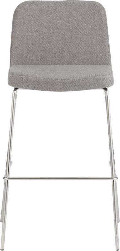 """<span class=""""copyHeader"""">raise the bar.</span> Pull up for a double…and stay awhile. Dapper seat sits comfy at the bar, upholstered in warm grey herringbone menswear. Tailored trim in carefree acrylic with welt detail that traces rounded corners from curved shoulders to edge of seat. Tubular metal legs stand spare and sleek in polished nickel finish.<br /><br /><NEWTAG/><ul><li>100% acrylic upholstery in warm grey herringbone</li><li>Padded seat and back</li><li>Nickel plated tubular metal legs</li><li>30""""H seat sized for bars</li></ul>"""