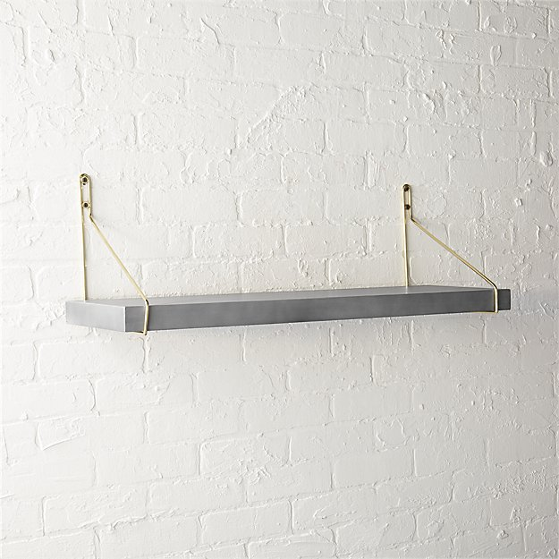 clad shelf with gold brackets