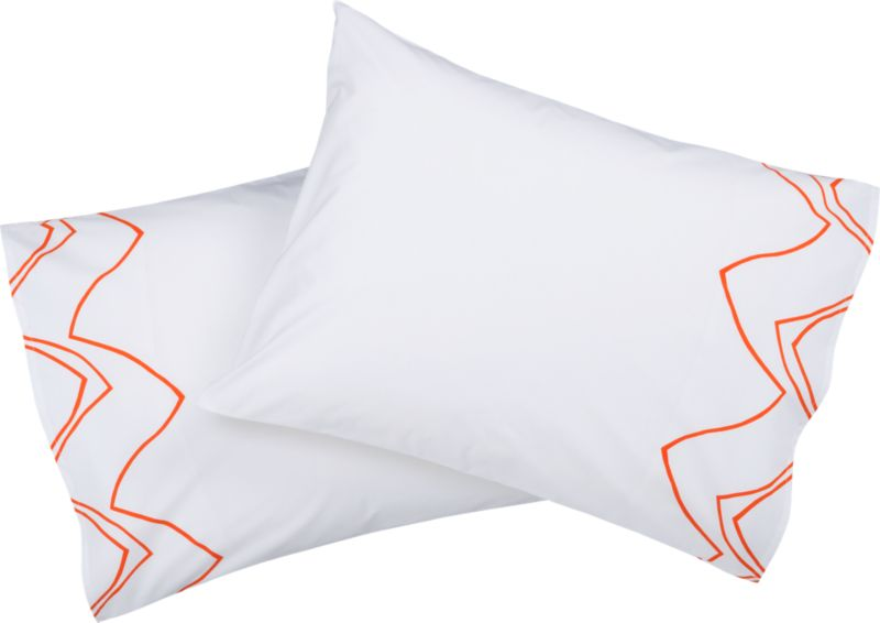 """<span class=""""copyHeader"""">chat line.</span> Chicago-based designer Noël Ashby gets the conversation started with a graphic tangle of bold orange lines on brite white 200-thread-count organic cotton. Ashby translated the rhythmic hum and pulse of conversation into an expressive abstraction of nonstop chatter, the words disappearing into a network of visual noise. Mostly white shams zig and zag with matching pattern on outer edge, both sides. Finished neat with envelope closure.<br /><br /><NEWTAG/><ul><li>Designed by Noël Ashby</li><li>100% cotton percale</li><li>200 thread count</li><li>Shams have envelope closure</li><li>Reverse to matching pattern</li><li>Machine wash</li></ul>"""