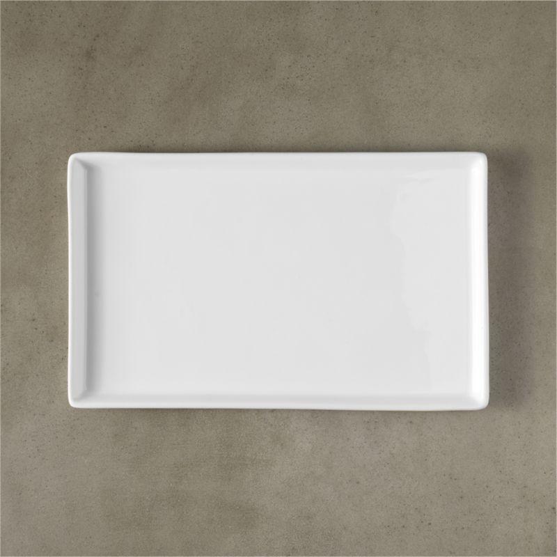 "<span class=""copyHeader"">slim rim. </span> A clean skim of a raised rim platter in gleaming white durable porcelain. Large, medium and small to layer. Medium doubles as an unconventional dining plate shape.<br /><br /><NEWTAG/><ul><li>Versatile size/shape</li><li>High quality porcelain</li><li>Dishwasher-, microwave- and conventional oven-safe</li></ul>"
