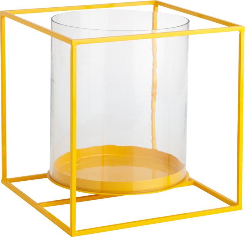 "<span class=""copyHeader"">light box.</span> Bright yellow steel rod lantern pedestals two pillar candles in an open-air design. Floating, flickering light sets the colorful frame aglow at the indoor or outdoor dining table.<br /><br /><NEWTAG/><ul><li>Mild steel rod</li><li>Epoxy finish</li><li>Glass hurricane holds two 3""x6"" pillar candles</li><li>Indoor and outdoor use</li><li>Wipe clean with damp cloth</li></ul>"