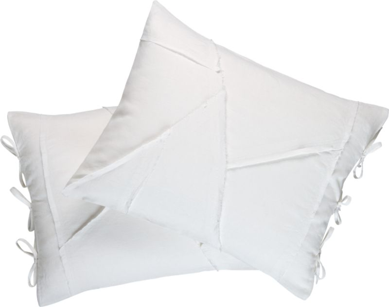 """<span class=""""copyHeader"""">nice threads.</span> Fashionably frayed 100% linen panels puzzle together edgy seam in fresh white on white. Shams reverse to solid white with side tie closures.<br /><br /><NEWTAG/><ul><li>100% linen</li><li>Reverses to solid white</li><li>Machine wash cold</li></ul>"""