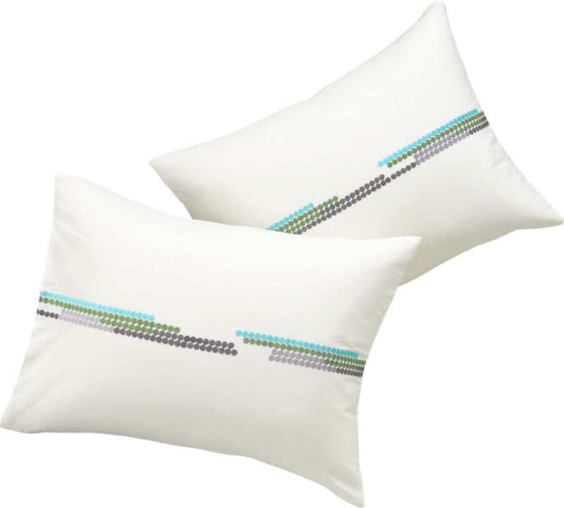 "<span class=""copyHeader"">the dotted line.</span> Staccato lines of mod dots stagger embroidered texture in aqua, green, silver, charcoal and light blue on off-white 100% cotton. Horizontal design subtly shifts in pattern and gradient, brightening and darkening in unpredictable rhythm. Finished neat with envelope closures. Sleeps sound with matching duvet.<br /><br /><NEWTAG/><ul><li>100% cotton</li><li>100% rayon embroidery on off-white</li><li>Reverses to solid off-white</li><li>Envelope closures</li><li>Machine wash</li></ul>"