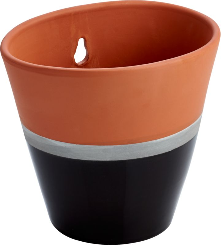 "<span class=""copyHeader"">hot dip.</span> Handmade by Portuguese artisans, terracotta vessel is fired and dipped to color block effect. Slick black glaze pops in modern contrast to earthy matte terracotta, separated by a slim silvery band. Suspends greens from back cutout.<br /><br /><NEWTAG/><ul><li>Handmade</li><li>Terracotta</li><li>Partially dip-glazed black</li><li>Cutout for easy hanging</li><li>Indoor/outdoor use</li><li>Wipe with clean, damp cloth</li></ul><br />"