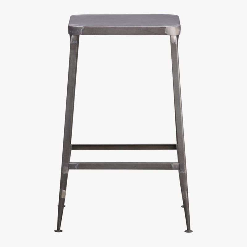 "<span class=""copyHeader"">quintessential.</span> Factory-inspired stool parks square at the bar in flint steel with raw metal finish, exposed welding. Legs flare refined, love those little capped feet. Each a handcrafted original.<br /><br /><NEWTAG/><ul><li>Handcrafted steel with raw finish</li><li>Flared legs</li><li>Feet have protective pads</li><li>24""H seat sized for counters</li><li>Each is unique</li></ul>"