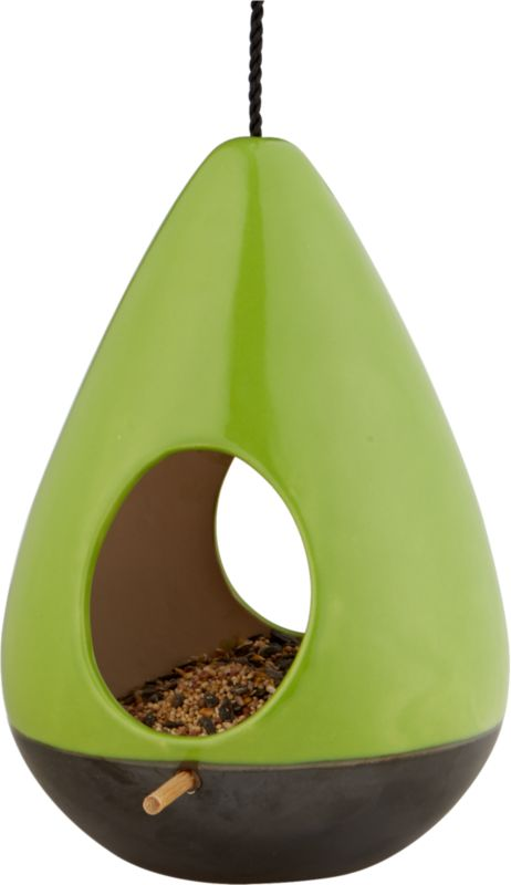 """<span class=""""copyHeader""""> tweet 'n' eat.</span> Teardrop habitat takes flight in green earthenware dipped below in brown reactive glaze. Two egg-shaped cutouts access wooden perch that's continuous side to side. Adjustable black rope suspends flight up to 16"""". Hang several at different heights for a fun flock.<br /><br /><NEWTAG/><ul><li>Green earthenware dipped in brown reactive glaze</li><li>For outdoor use</li><li>Clean with damp cloth</li></ul>"""