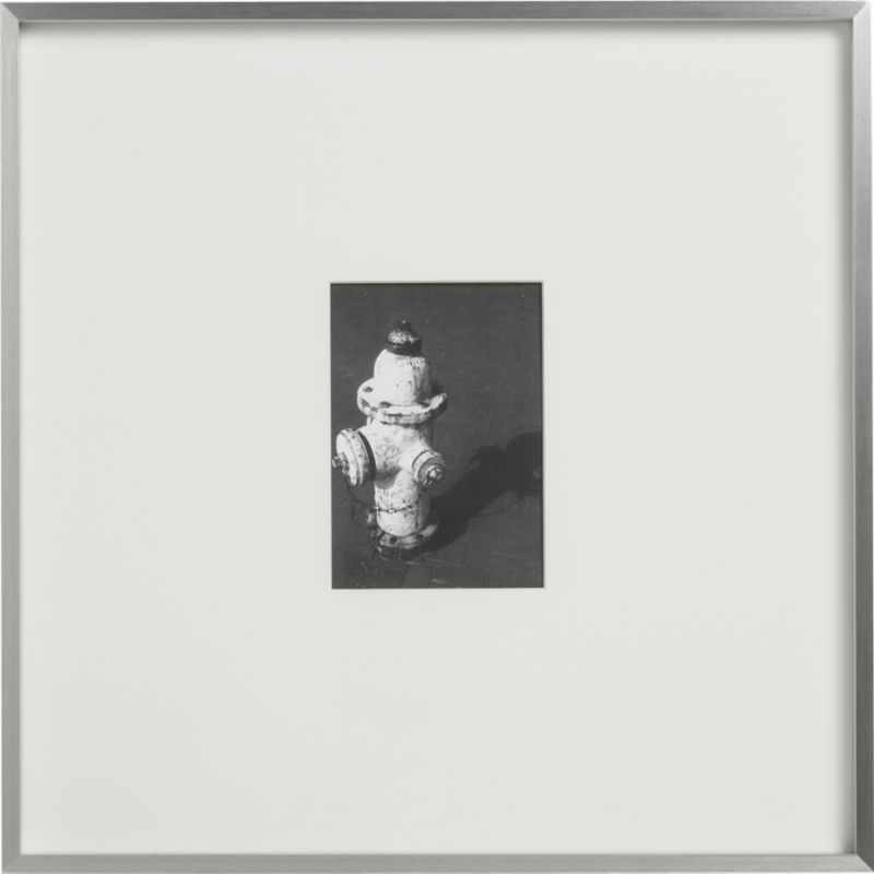 """<span class=""""copyHeader"""">up the art.</span> Brushed aluminum frames an XL white mat for gallery presentation of photos or images. 5x7s live in large square.<br /><br /><NEWTAG/><ul><li>Aluminum and glass</li><li>White mat</li><li>Display alone or in multiples</li><li>Hang on wall or stand on table</li></ul>"""