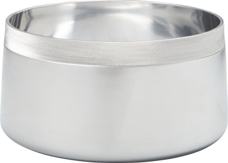 """<span class=""""copyHeader"""">metal band.</span> Slick polished aluminum bowl goes against the grain, rimmed with a contrasting band of tactile texture. Dishes up salad, pasta, popcorn with a refined industrial feel.<br /><br /><NEWTAG/><ul><li>Handmade</li><li>Cast polished aluminum with textured rim</li><li>Wipe clean with soft cloth</li></ul>"""