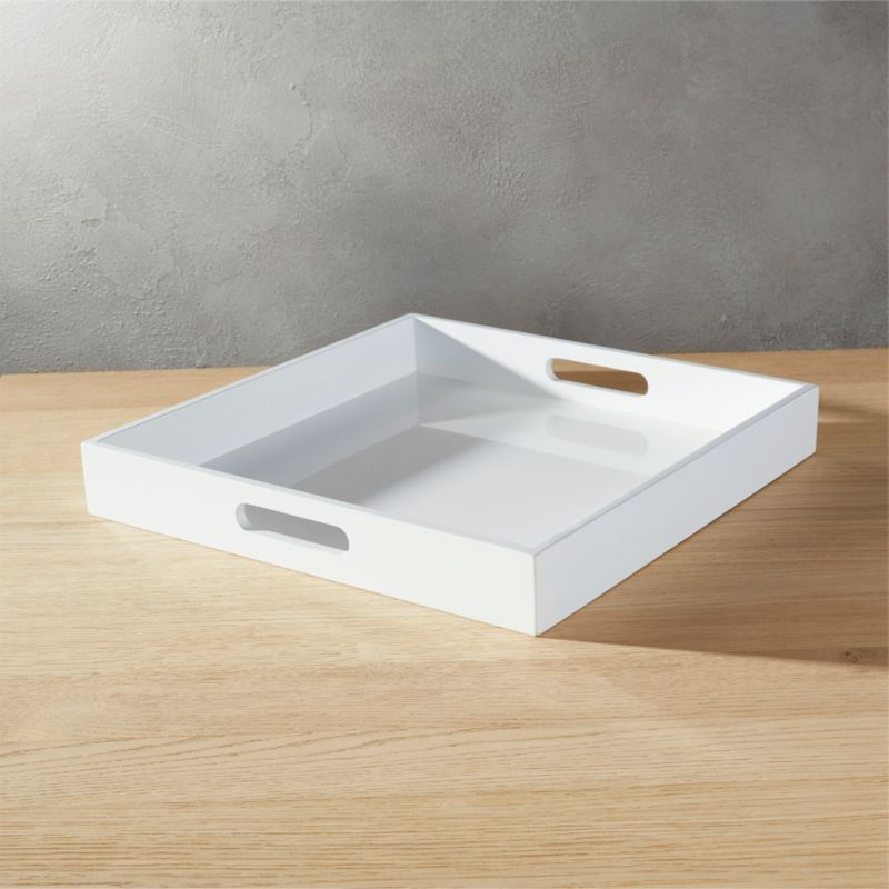 """<span class=""""copyHeader"""">room-to-room service.</span> Essential butler in white hi-gloss composite wood lends a hand with integrated handles. Raised rim adds edge, keeps it all in place. Also spiffs up organization in the office, bedroom, bathroom, living room.<br /><br /><NEWTAG/><ul><li>Use as server, desk accessory or table decor</li><li>Composite wood with hi-gloss white lacquer</li><li>Clean with soft dry cloth</li></ul>"""