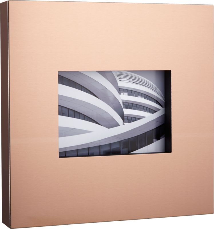 """<span class=""""copyHeader"""">modern metallic.</span> Finished in coppery matte rose gold, architectural steel square insets a 5""""x7"""" photo. Freestands or frames the wall with broad, overscaled border. Capture a modern moment with kat neon peach 5""""x7"""" frame.<br /><br /><NEWTAG/><ul><li>Steel frame</li><li>Copper/rose-gold powdercoat finish</li><li>Glass cover</li><li>Holds 5""""x7"""" photo</li><li>Wipe with soft, dry cloth</li></ul>"""