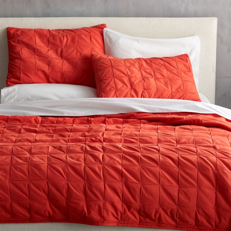 """<span class=""""copyHeader"""">grid block.</span> Handstitched modern quilt squares up textural blocks in a pop of red-orange. 100% cotton quilt reverses to solid red-orange.<br /><br /><NEWTAG/><ul><li>Handstitched</li><li>100% cotton</li><li>100% poly fill</li><li>Quilt reverses to solid red-orange</li><li>Machine wash</li></ul>"""