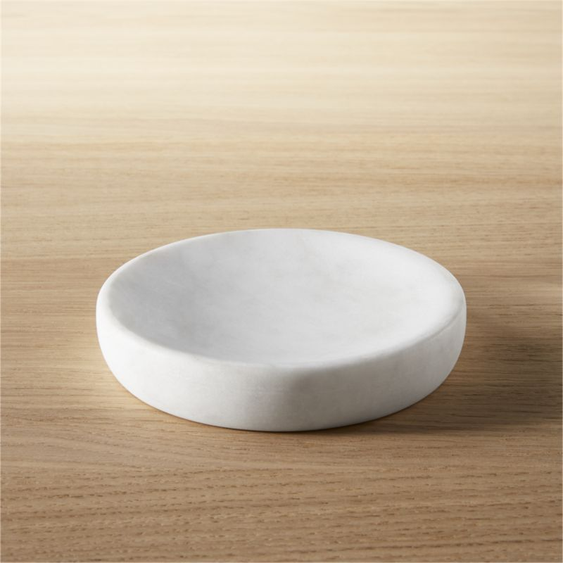 """<span class=""""copyHeader"""">modern rock.</span> Carve out a neat spot in the bath. Honed smooth, marble soap disk rocks a spa vibe in soft white with naturally occurring swirls of grey.<br /><br /><NEWTAG/><ul><li>Marble</li><li>Honed smooth</li><li>Naturally occurring grey tones will vary; each is unique</li><li>Wipe clean with damp cloth</li></ul>"""
