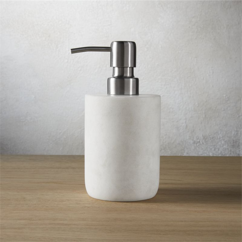 """<span class=""""copyHeader"""">modern rock.</span> Carve out a neat spot in the bath. Honed smooth, marble soap pump rocks a spa vibe in soft white with naturally occurring swirls of grey.<br /><br /><NEWTAG/><ul><li>Marble</li><li>Honed smooth</li><li>Naturally occurring grey tones will vary; each is unique</li><li>Wipe clean with damp cloth</li></ul>"""