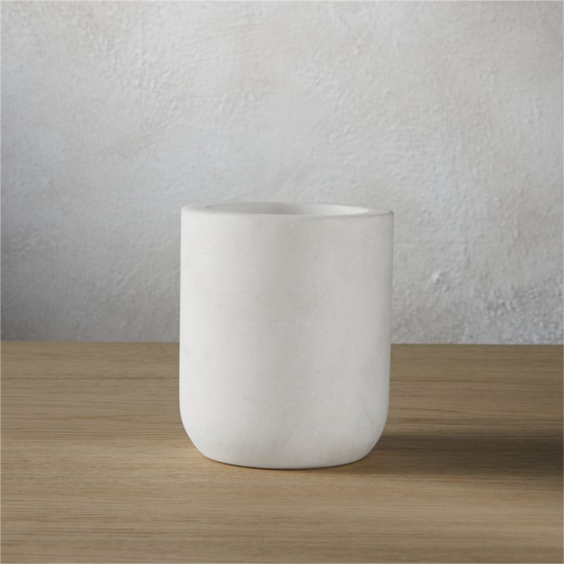 """<span class=""""copyHeader"""">modern rock.</span> Carve out a neat spot in the bath. Honed smooth, multipurpose marble cup rocks a spa vibe in soft white with naturally occurring swirls of grey.<br /><br /><NEWTAG/><ul><li>Marble</li><li>Honed smooth</li><li>Naturally occurring grey tones will vary; each is unique</li><li>Wipe clean with damp cloth</li></ul>"""