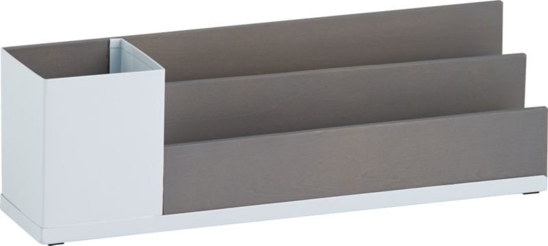 """<span class=""""copyHeader"""">dual nature.</span> Two-tone catchall is a modern fusion of mixed materials: white powdercoated steel and birch veneered plywood stained a warm grey that accentuates the wood grain. Built-in cup holds pencils, pens, tacks, doodads. Two linear slots sort mail, bills notes.<br /><br /><NEWTAG/><ul><li>White powdercoated steel and birch veneered plywood with warm grey stain</li><li>Built-in pencil cup; two slots to sort mail, bills, notes</li><li>Wipe with damp cloth</li></ul>"""