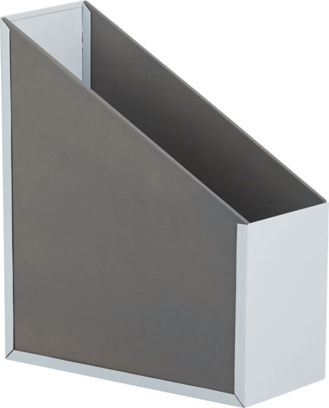 """<span class=""""copyHeader"""">dual nature.</span> Two-tone library ups your readership in a modern fusion of mixed materials: white powdercoated steel and birch veneered plywood stained a warm grey that accentuates the wood grain. A graphic home for special editions and publications.<br /><br /><NEWTAG/><ul><li>White powdercoated steel and birch veneered plywood with warm grey stain</li><li>Holds up to 12 standard size magazines</li><li>Wipe with damp cloth</li></ul>"""