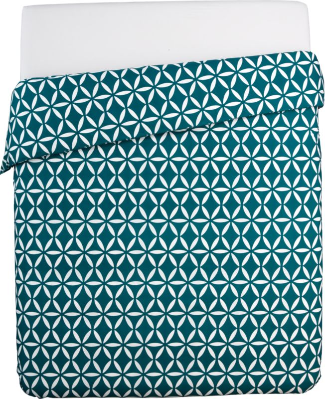 "<span class=""copyHeader"">dream sequence.</span> Inspired by Moroccan tile patterns, white geometric shapes radiate in linear repetition on soft 200-thread-count cotton in swoon blue. Reversible duvet has non-slip corner ties and hidden button closure. Mix and match with coordinating shams to positive/negative effect in yellow, grey or swoon blue.<br /><br /><NEWTAG/><ul><li>100% cotton</li><li>200 thread count</li><li>Duvet has non-slip corner ties and hidden button closure; reverses to matching pattern</li><li>Machine wash warm; do not dry clean</li></ul>"