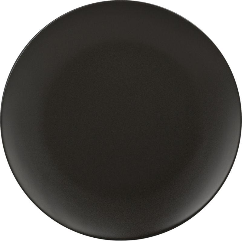"<span class=""copyHeader"">black out.</span> Dramatic round plates up a bold presentation that makes food pop in matte black stoneware with soft curved rim. All-black wardrobe goes with everything, so layer with whiteware, prints, metallics.<br /><br /><NEWTAG/><ul><li>Porcelain</li><li>Matte black glaze</li><li>Dishwasher- and microwave-safe</li></ul>"