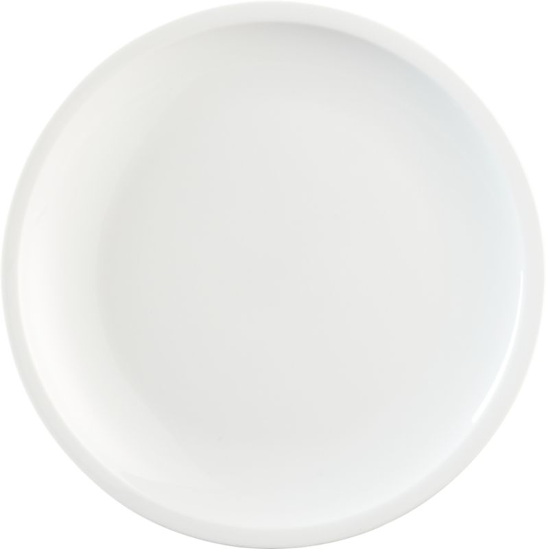 "<span class=""copyHeader"">slim rim.</span> Minimal flat rim skims the edge of clean white porcelain round. Sides slope to dish generously.<br /><br /><NEWTAG/><ul><li>Porcelain dipped in white glaze</li><li>Dishwasher- and microwave-safe</li></ul>"