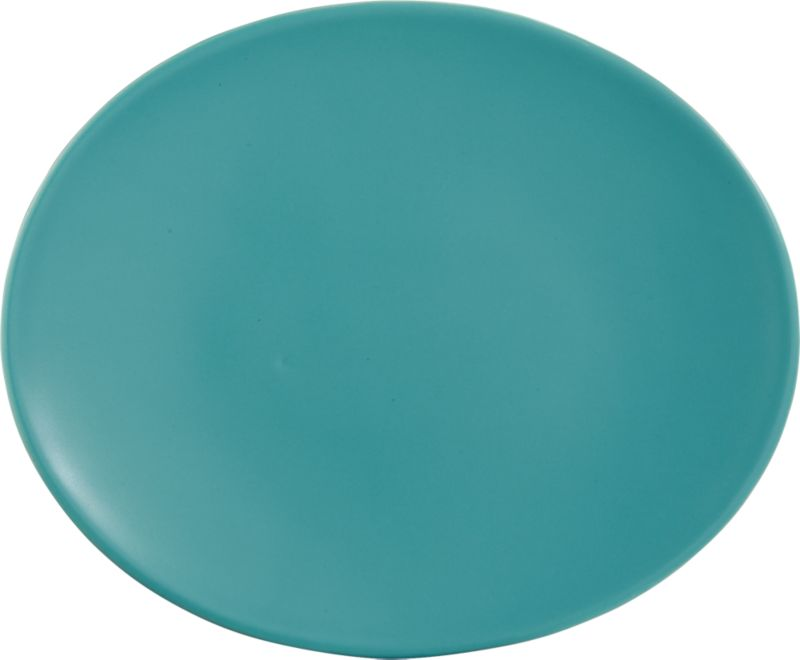 """<span class=""""copyHeader"""">palette for the palate.</span> Bright aqua oval brings a fresh perspective to the table, handmade of earthenware with modern matte glaze. Layer with oval blue-green dinner plate and oval yellow bowl for a new color story.<br /><br /><NEWTAG/><ul><li>Handmade</li><li>Earthenware</li><li>Matte aqua glaze</li><li>Dishwasher- and microwave-safe</li></ul>"""