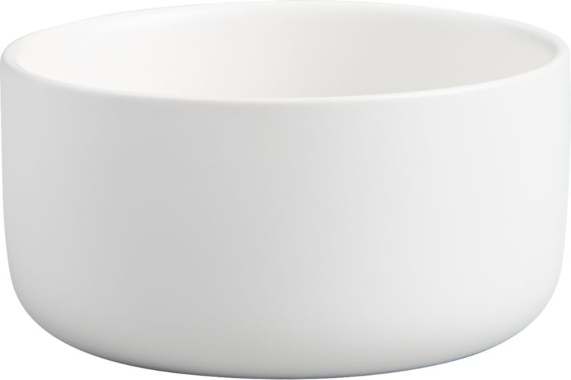 """<span class=""""copyHeader"""">deep dish.</span> Brite white round tops the table as one part minimalist sculpture, one part serves-it-all bowl. Handmade of stoneware glazed matte white inside and out, modern design has high sides and smooth contours to dish everything from salad to pasta.<br /><br /><NEWTAG/><ul><li>Handmade</li><li>Stoneware with matte white glaze</li><li>Dishwasher-, microwave- and oven-safe</li></ul>"""