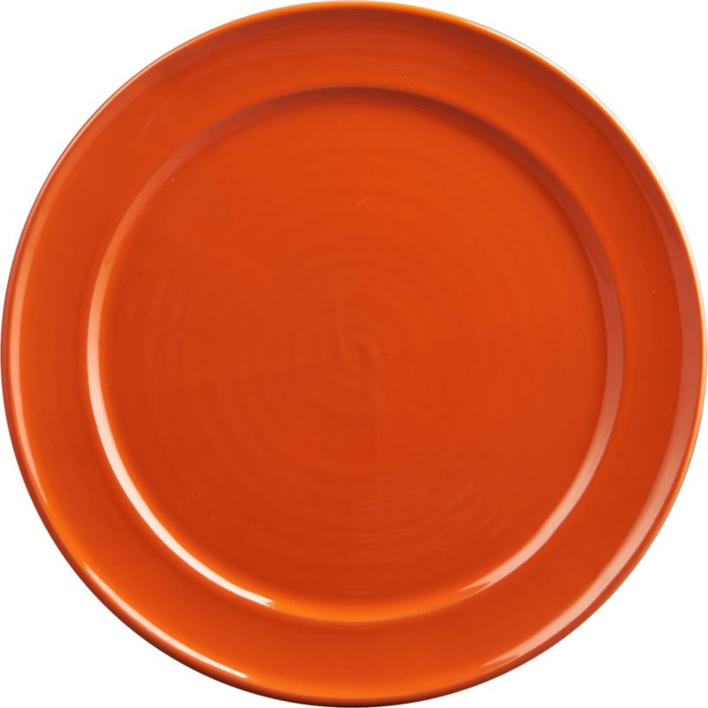 "<span class=""copyHeader"">play on clay.</span> Rimmed terracotta round pops in glossy orange reactive glaze that makes each unique. Dines in bold contrast to react aqua dinner plate.<br /><br /><NEWTAG/><ul><li>Terracotta</li><li>Orange reactive glaze; each is unique</li><li>Microwave- and oven-safe</li><li>Hand wash</li></ul>"