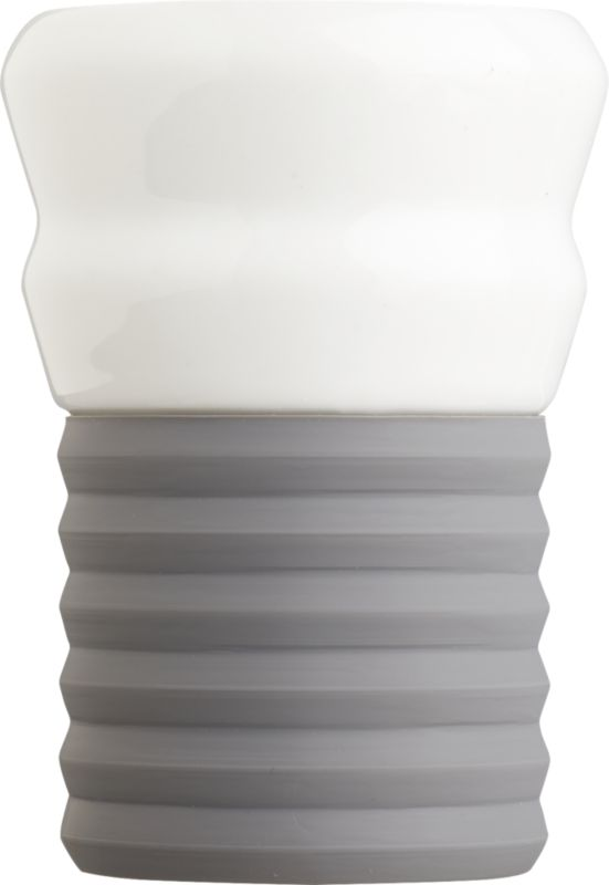 """<span class=""""copyHeader"""">espresso yourself.</span> Add a shot of color to your morning or nightly caffeine routine. Hand-dipped porcelain cup tucks into removable ribbed silicone bottom in subdued grey. Ridged grip feels good in the hand.<br /><br /><NEWTAG/><ul><li>Hand-dipped porcelain</li><li>Removable ribbed silicon base</li><li>Dishwasher-safe</li></ul><br />"""