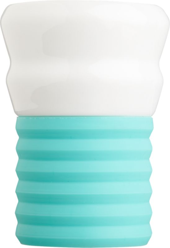 "<span class=""copyHeader"">espresso yourself.</span> Add a shot of color to your morning or nightly caffeine routine. Hand-dipped porcelain cup tucks into removable ribbed silicone bottom in buzz-inducing aqua. Ridged grip feels good in the hand.<br /><br /><NEWTAG/><ul><li>Hand-dipped porcelain</li><li>Removable ribbed silicon base</li><li>Dishwasher-safe</li></ul>"