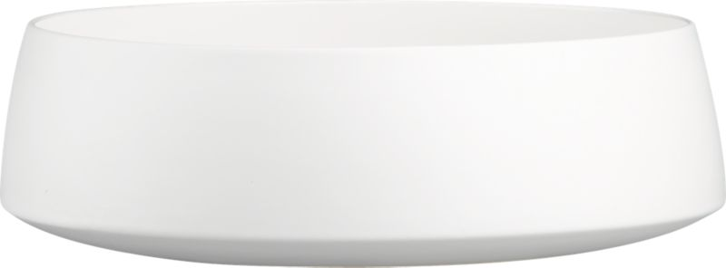 """<span class=""""copyHeader"""">the low down.</span> Simplicity and utility keep a low profile in matte white stoneware with slick white interior. Raised bottom edge and subtle tapered rim shelter salad, pasta and chips for an XL crowd.<br /><br /><NEWTAG/><ul><li>Stoneware</li><li>Matte white exterior; high-gloss white interior</li><li>Dishwasher-, microwave- and oven-safe (up to 350-degrees)</li></ul>"""
