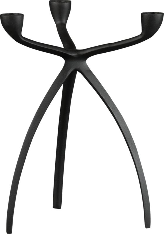 "<span class=""copyHeader"">glow with the flow.</span> Fluid sculpture stances graphic on bowed tripod legs that appear to be captured in motion. Handcast in black powdercoated aluminum, modern candleabra gives rise to three tapers—real flickers or our tric LED candle. Casts a striking glow with tri taper candleholder small white.<br /><br /><NEWTAG/><ul><li>Handcrafted</li><li>Black powdercoated aluminum</li><li>Holds three taper candles</li></ul>"