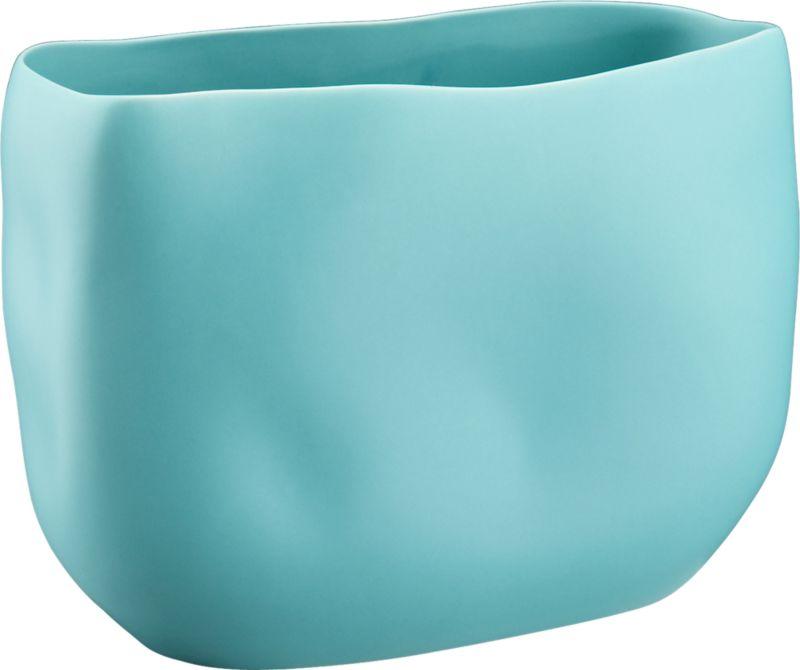 "<span class=""copyHeader"">organic arrangement.</span> Stoneware vessel freeforms a softly grooved organic shape in a matte pop of aqua. Pair hi/lo, shiny/matte with trough glossy yellow vase.<br /><br /><NEWTAG/><ul><li>Stoneware</li><li>Matte aqua finish</li><li>Water-tight</li><li>Wipe with soft, dry cloth</li></ul>"