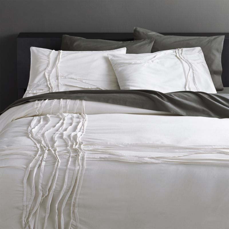 "<span class=""copyHeader"">monochromatic merge.</span> White-on-white sleepscape dreams up tone-on-tone texture. Woven of soft cotton/linen, flowing ribbons of fabric cross paths off-center in an organic ripple effect. Duvet reverses to solid white. Duvet has non-slip corner ties and hidden button closure.<br /><br /><NEWTAG/><ul><li>Cotton/linen</li><li>250 thread count</li><li>Duvet has non-slip corner ties and hidden button closure; reverses to solid white</li><li>Machine wash; line dry</li></ul>"