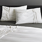 set of two twisted white shams.