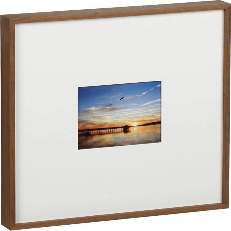 """<span class=""""copyHeader"""">new focus.</span> Simple walnut veneer frame ups the ante and the wall with an unexpected matte in off-white engineered wood. Mid-century aesthetic borders prints and pictures with clean perspective. Hang vertical/horizontal, or lean against wall.<br /><br /><NEWTAG/><ul><li>Walnut veneer over engineered wood</li><li>Off-white lacquered composite wood matte</li><li>Hang vertically or horizontally or lean against the wall</li></ul>"""