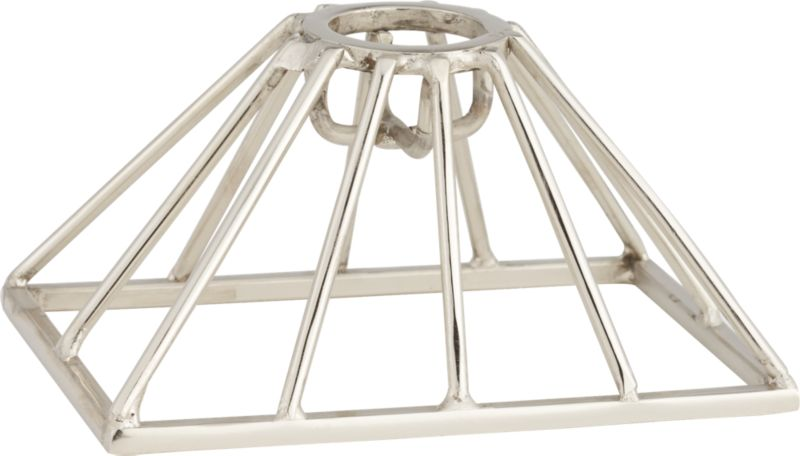 """<span class=""""copyHeader"""">new spindle.</span> Hand-welded of gleaming nickel-plated stainless steel, sculptural pyramid elevates a single taper in a linear web of silver. Candle sold separately.<br /><br /><NEWTAG/><ul><li>Hand-welded</li><li>Stainless steel</li><li>Nickel-plated finish</li><li>Holds one taper candle, sold separately</li><li>Wipe with clean, damp cloth</li></ul>"""