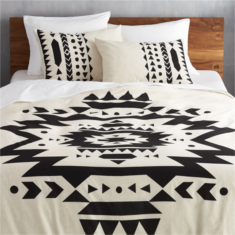 "<span class=""copyHeader"">desert daze.</span> Aztec-inspired black ikat pattern makes big, bold impression atop off-white cotton/linen blend landscape. Duvet cover has nonslip corner ties and hidden button closure; reverses to solid off-white. Dreamy with matching shams.<br /><br /><NEWTAG/><ul><li>Cotton/linen blend</li><li>Nonslip corner ties and hidden button closure</li><li>Reverses to solid off-white</li><li>Machine wash cold</li></ul><br />"