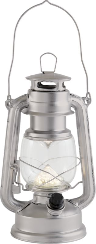 """<span class=""""copyHeader"""">camp sight.</span> Intricate iron lantern sheds modern new LED light on old-school oil designs. Powdercoated slick silver, indoor/outdoor lantern safely adds a warm glow on the patio, camps out or dines inside. Lights the way with two DD batteries (not included).<br /><br /><NEWTAG/><ul><li>Iron</li><li>LED bulb</li><li>Requires two DD batteries (not included)</li><li>Plastic knob</li><li>Wipe with soft cloth</li></ul>"""