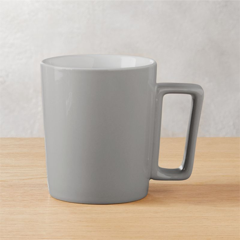 "<span class=""copyHeader"">wakeup call.</span> Beam up the caffeine in this XL stoneware mug glazed grey outside, glossy white inside. Oversized squared handle provides a good grip.<br /><br /><NEWTAG/><ul><li>Stoneware</li><li>Exterior: Grey glaze; Interior: glossy white glaze</li><li>Dishwasher- and microwave-safe</li></ul>"