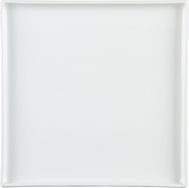 """<span class=""""copyHeader"""">square meal.</span> Go-to, go with everything dinnerware turns a corner in smart white stoneware. Raised rims square off interactive plates.<br /><br /><NEWTAG/><ul><li>Durable glazed stoneware</li><li>Dishwasher- and microwave-safe</li></ul>"""