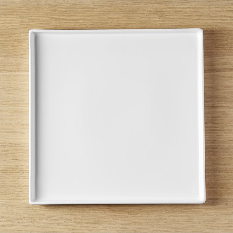 """<span class=""""copyHeader"""">square meal.</span> Go-to, go with everything dinnerware turns a corner in smart white stoneware. Raised rims square off interactive plates.<br /><br /><NEWTAG/><ul><li>Durable glazed stoneware</li><li>Dishwasher- and microwave-safe; oven-safe at 350-degrees for no more than two hours</li></ul>"""
