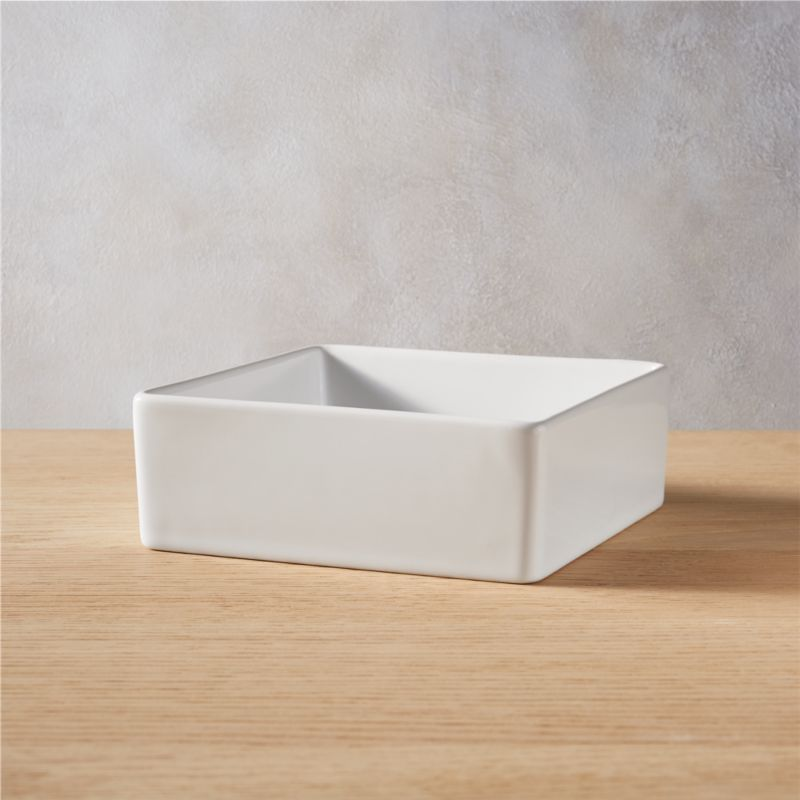 """<span class=""""copyHeader"""">square meal.</span> Go-to, go with everything dinnerware turns a corner in smart white stoneware. Deep square bowls think outside the box.<br /><br /><NEWTAG/><ul><li>Durable glazed stoneware</li><li>Dishwasher- and microwave-safe; oven-safe at 350-degrees for no more than two hours</li></ul>"""