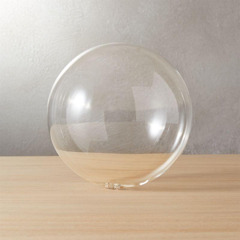 "<span class=""copyHeader"">blowing bubbles.</span> Handblown glass sphere is light as a bubble with small hole from the glassblower's rod.<br /><br /><NEWTAG/><ul><li>Handblown glass</li><li>Hollow and feather light</li></ul>"